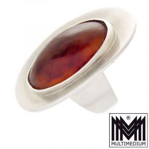 Ausgefallener schöner Modernist Bernstein Silber Ring von Nils Erik FROM, Denmark gest.:Sterling NE FROM Denmark 925S (siehe Foto) in einem guten schönen Erhaltungszustand Ringgröße: 56 cm Breite des Ringes: 1,46 cm Höhe des Ringes: 3 cm