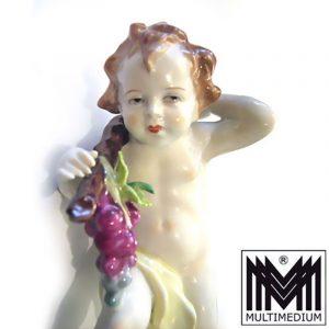 alte antike Porzellan Figur Kind mit Trauben Sitzendorf farbig bemalt